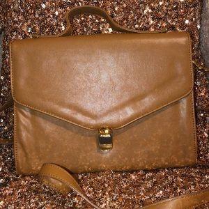 Brown leather satchel with long shoulder strap